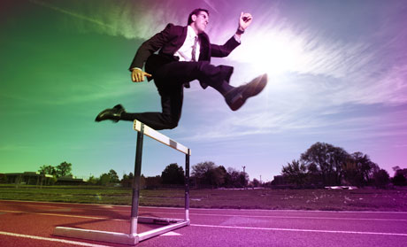 Business Man Jumping Hurdles